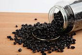 Black Beans In A Jar On Wood Table