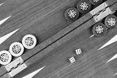 Backgammon Table And Double Six Dice Closeup Black And White