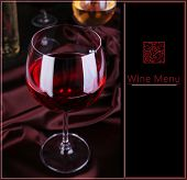 Glass of red wine on dark fabric background with space for text, Wine Menu