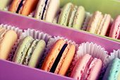 Assortment of gentle colorful macaroons in box, close-up