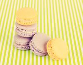 Tasty macaroons on green striped background