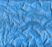 Rough creased blue paper texture