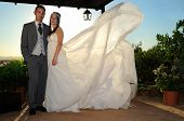 Bride And Groom Under A Porch Full Length