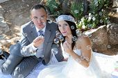 Groom Bride Sitting Doing Soap Bubbles Outdoor
