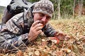 young man biting mushroom