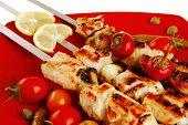 fresh roast shish kebab on red platter