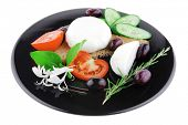 soft feta cheese on black plate with bread and vegetables
