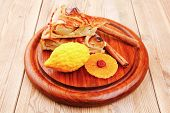 sweet apple cake on wooden table with lemon and cinnamon sticks