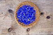 Blur Fresh Medical Cornflower Blossoms In Wicker Plate
