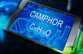 foto of camphor  - the chemical formula of camphor on a tablet with test tubes - JPG
