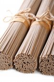 Raw Buckwheat Soba Noodles Macro  Isolated Vertical