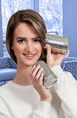 picture of tin can phone  - Woman talikng on a primative tin can phone