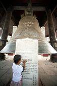 Boy Reading Label Of Mingun Bell In Myanmar.