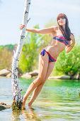 Slim Girl In Swimsuit Posing On The Lake