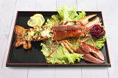 lagre lobster on black plate