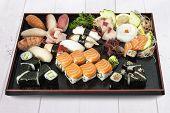 Sushi, sashimi set on black plate