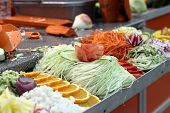 Sliced Vegetables On A Counter