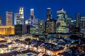 Aerial View Of Singapore's Chinatown And Skyline At Dusk