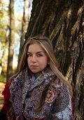 Girl With Her Blond Hair On Background Autumn Trees