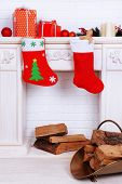 Fireplace with Christmas decoration on brick wall background