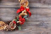 Christmas wreath on rustic wooden background