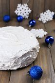 Christmas cake on wooden table background