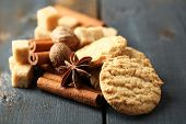 Christmas spices and baking ingredients on color wooden background