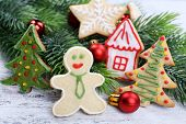 gingerbread cookies with Christmas decoration on color wooden table background