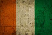 stock photo of yamoussoukro  - Grunge of Ivory Coast Flag painted on old paper background - JPG
