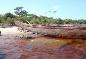 stock photo of canaima  - Indian boat at the beach in Canaima lagoon - JPG