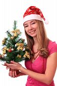 Beautiful girl in a cap with Christmas tree.