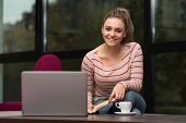 Happy Student At Cafe Using Laptop