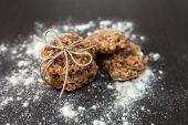 picture of baked raisin cookies  - oatmeal cookies with raisins and flour on wooden table - JPG