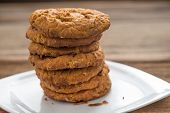Stacked Chocolate Chip Cookies  On Wooden Table