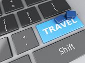 travel suitcase on computer keyboard. Travel concept