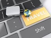 travel suitcase and earth on computer keyboard. Travel concept