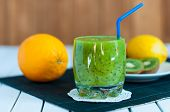 picture of light weight  - Healthy homemade kiwi juice in glass and fresh orange - JPG