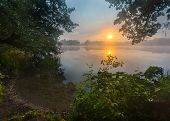 Постер, плакат: Beautiful Sunrise Over Misty Lake