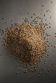 stock photo of flax seed oil  - Top view of  whole flax seed on dark background - JPG