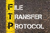 picture of transfer  - Business Acronym FTP as FILE TRANSFER PROTOCOL. Yellow paint line on the road against asphalt background. Conceptual image - JPG