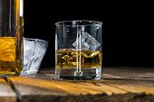 foto of malt  - Single Malt Whiskey with Ice Cubes on wooden background - JPG
