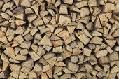 image of neat  - Plenty of firewood Neatly Stacked together (pine) ** Note: Soft Focus at 100%, best at smaller sizes - JPG