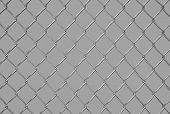 stock photo of slit  - metallic steel mesh on gray background texture - JPG