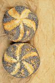 picture of bap  - close up of two poppy seed rolls on greaseproof paper - JPG