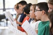 picture of drama  - Group Of School Children Singing In Choir Together - JPG