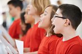 stock photo of children group  - Group Of School Children Singing In Choir Together - JPG