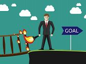 picture of goal setting  - Successful young businessman setting the bridge behind him on fire and going to his goal - JPG