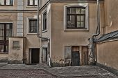 stock photo of downspouts  - House with downpipes on the backstreet - JPG