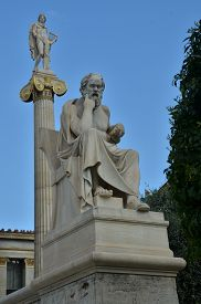 image of plinth  - A statue on a plinth outside the university of Athens - JPG