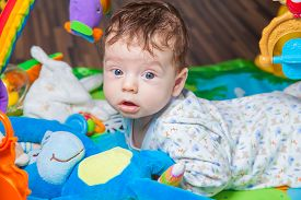 pic of playmate  - 3 months old baby boy playing and learning on the playmat - JPG